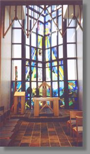Click for a larger image. A very sensitive approach, this window portrays a modern rendition of Jesus which works well in the school environment.